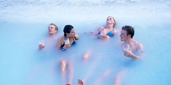 Drinking in the Blue Lagoon, Iceland | Group travel